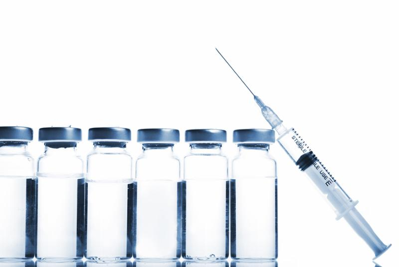 Glass Medicine Vials and botox hualuronic collagen or flu Syringe on a white background.