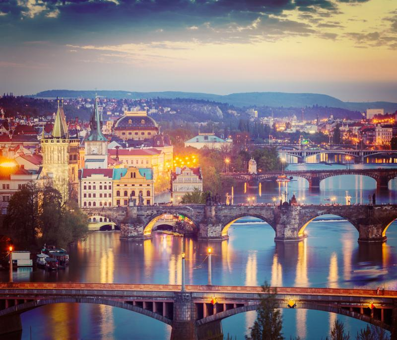 Vintage retro hipster style travel image of travel Prague concept background - elevated view of bridges over Vltava river from Letn              Park. Prague, Czech Republic in twilight