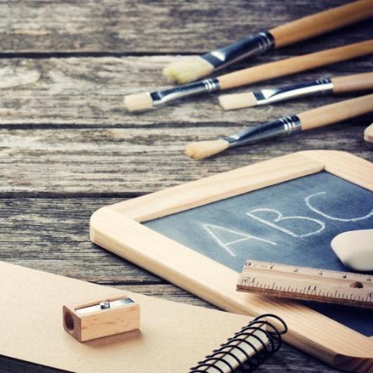 School supplies in brown tone on wooden desk