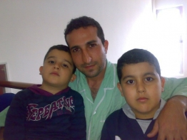 Youcef Nadarkhani with his two children