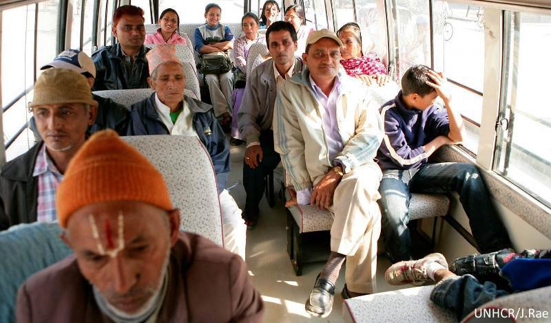 Bhutanese refugees on bus