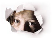 A child_s dirty face peers through torn white paper _logo for Disability Rights International_