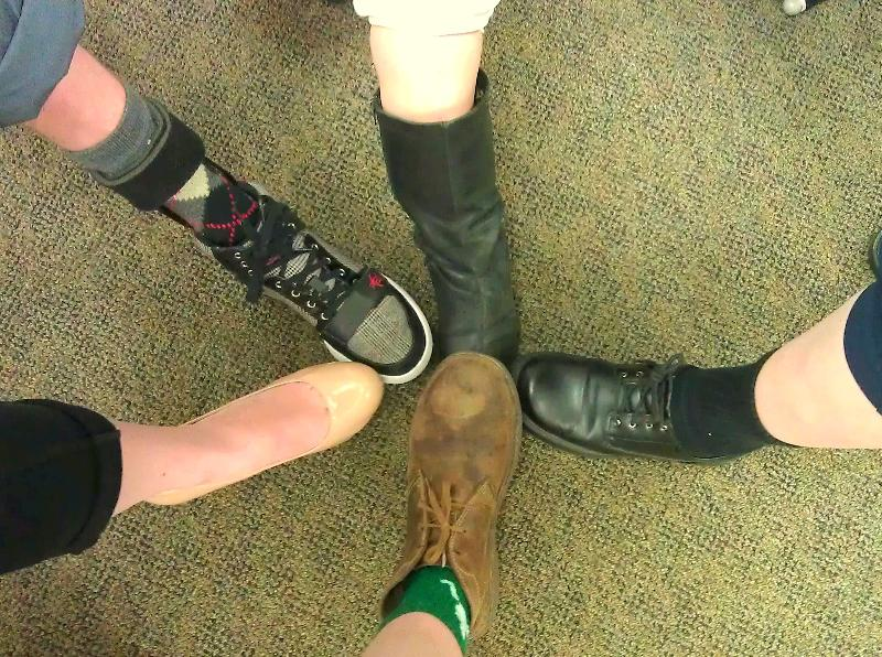 USICD Staff with left pant legs rolled up for Lend a Leg Campaign