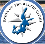 On a white circle and over a gray tone compas rose, a blue image of the Baltic Sea on a map is under the arching words,