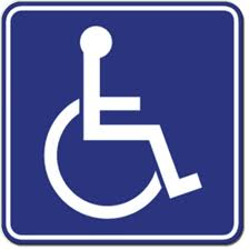 A blue square outlined with another blue square and athe symbol for a person sitting in a wheelchair in white