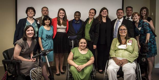 Group of interns, USICD staff and board, and funders post for group picture