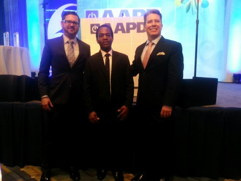 Novath Ruwango (center) joins AAPD CEO Mark Perriello (left) and USICD Executive Director David Morrissey at the annual AAPD gala on March 11, 2015 in Washington, DC.