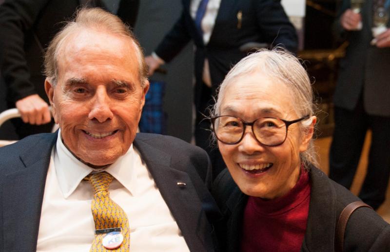 Senator Bob Dole posing with Yoshiko Dart