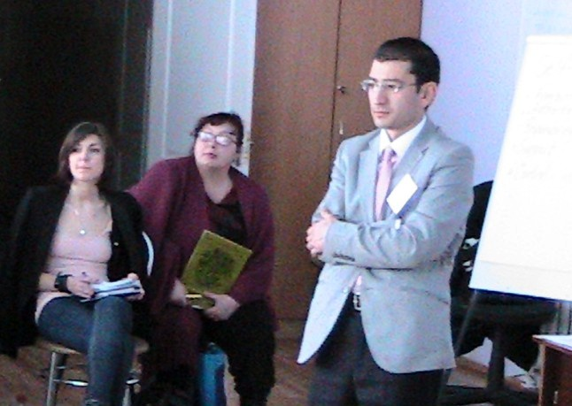 Sherzodbek Sharipov giving a presentation in Ukraine