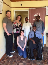 Three GWU students pose with three NONDO representatives, one seated in a wheelchair