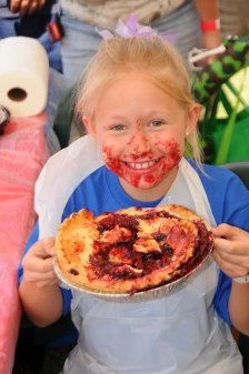 Girl with cherry pie on her face