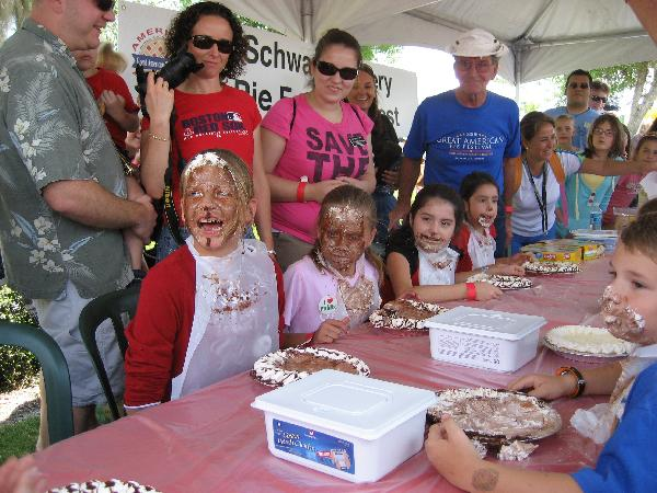 Children with their faces covered in pie