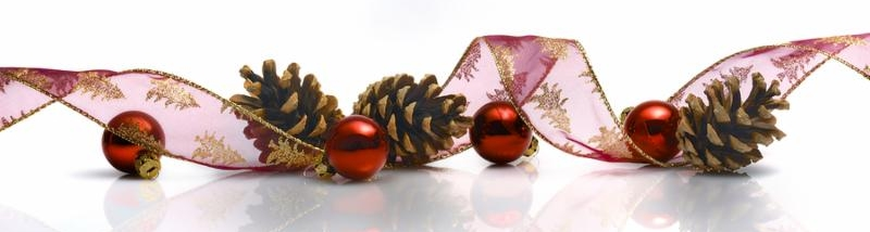 Christmas decoration with ribbon cones and red balls reflected on white background
