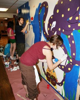 Jersey Cares volunteers painting mural