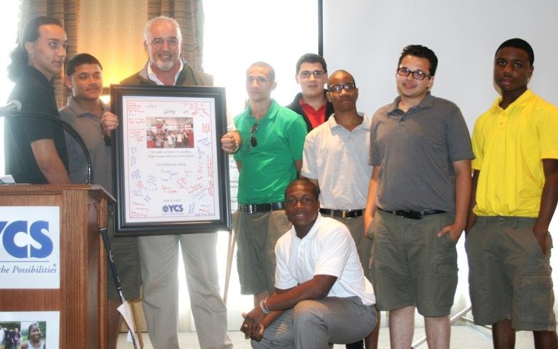 Jerry Cooney receives gift from young men