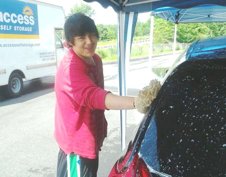 Boys volunteer at car wash
