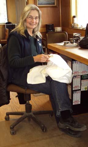 Linda embroidering a pillowcase
