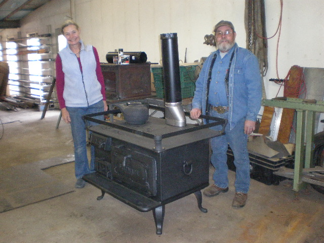 Capt Linda with new cook stove and builder