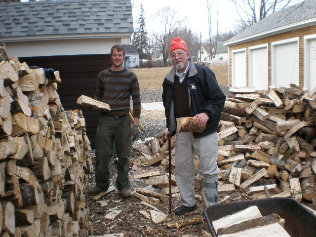 Doug and Keith stacking fire wood