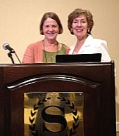 Susan Gregg-Schroeder and Carole Wills sharing a podium at NAMI