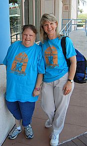 Two women in Disability Connection T-shirts