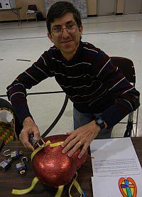 Volunteer demonstrating the symbolic locked heart