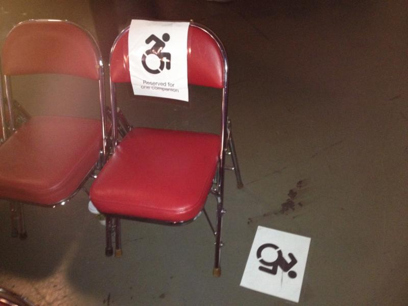 One companion seat and the floor space next to it marked with accessibility symbols