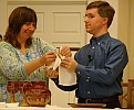 Pastors Lisa and Eric Pridmore serving communion