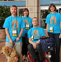 Task Force members and service dog in front of convention center