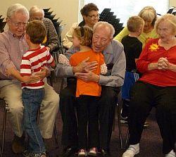 Respite program participants getting hugs from preschoolers