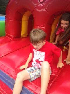 VBS children climbing through bouncy equipment