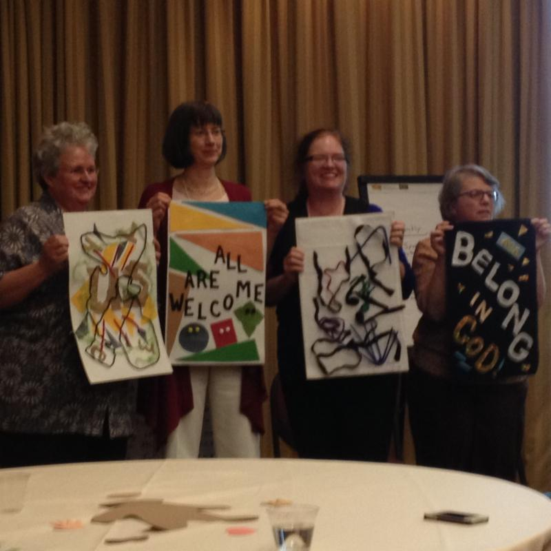 Group showing their artwork