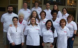 15 members of the DHM committee wearing their white committee shirts