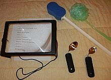 loan devices including page magnifier, bent spoons, and long sponges