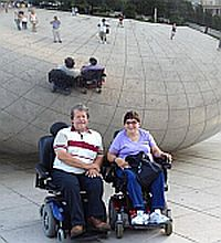 Rev. John and Rev. Lisa McKee in front of the Bean sculpture in Chicago's Millenium Park