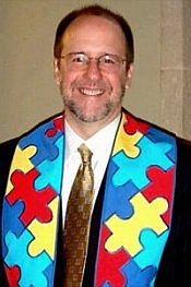 Kenny Dickson wearing his pieces of the puzzle autism awareness stole