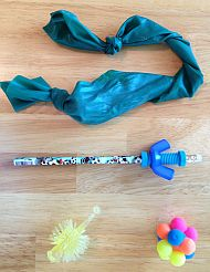 variety of fidgets including stretchy band, pencil with spinner bolt, and textured balls