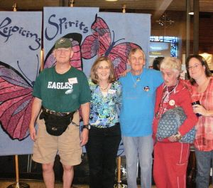group of worshipers in front of Rejoicing spirits butterfly banner