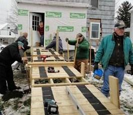 volunteers building modular ramp