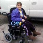 smiling girl in loaner power wheelchair