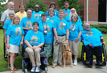 Group photo of committee in their blue T-shirts
