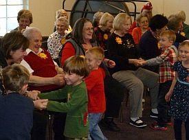 children greet smiling day program partipants