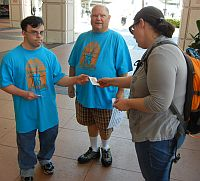Volunteers passing out Task Force info at General Conference