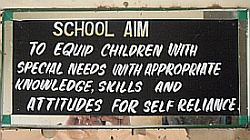 sign with aim of Njia school in Kenya