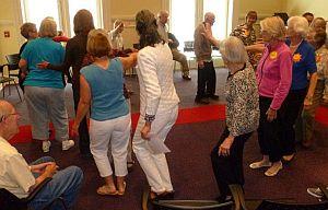 participants doing a circle dance