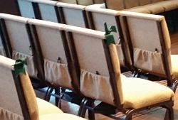 chair marked with green ribbons