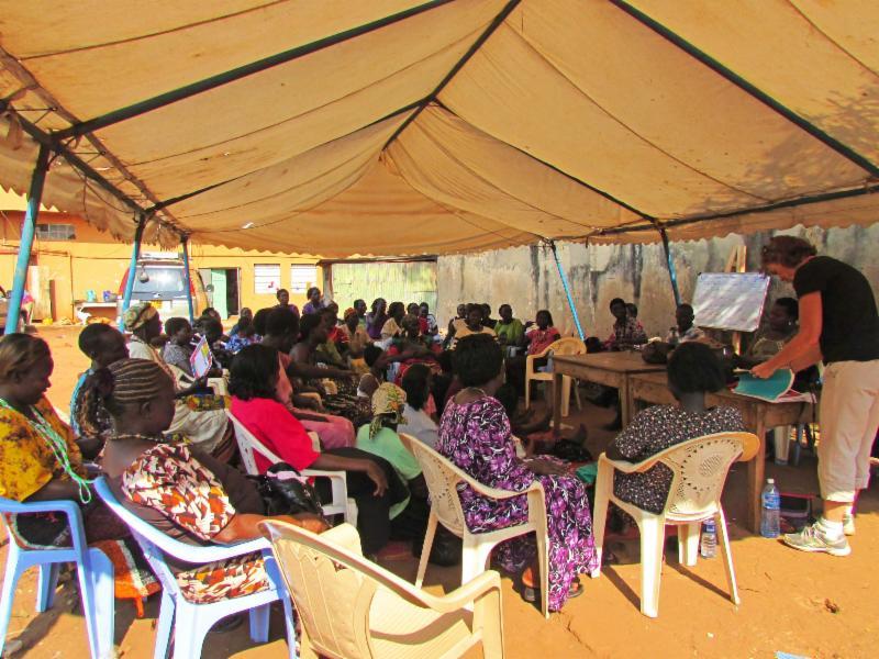 Mary teaching numeracy class in Jinja.