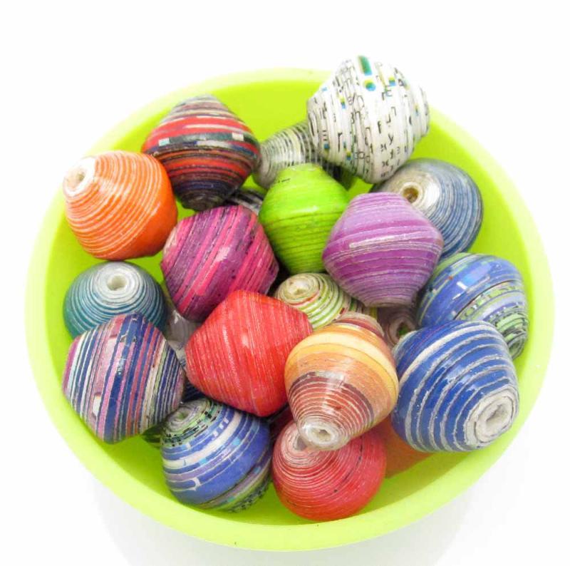 Smal bowl of loose beads, hand made and fair trade.