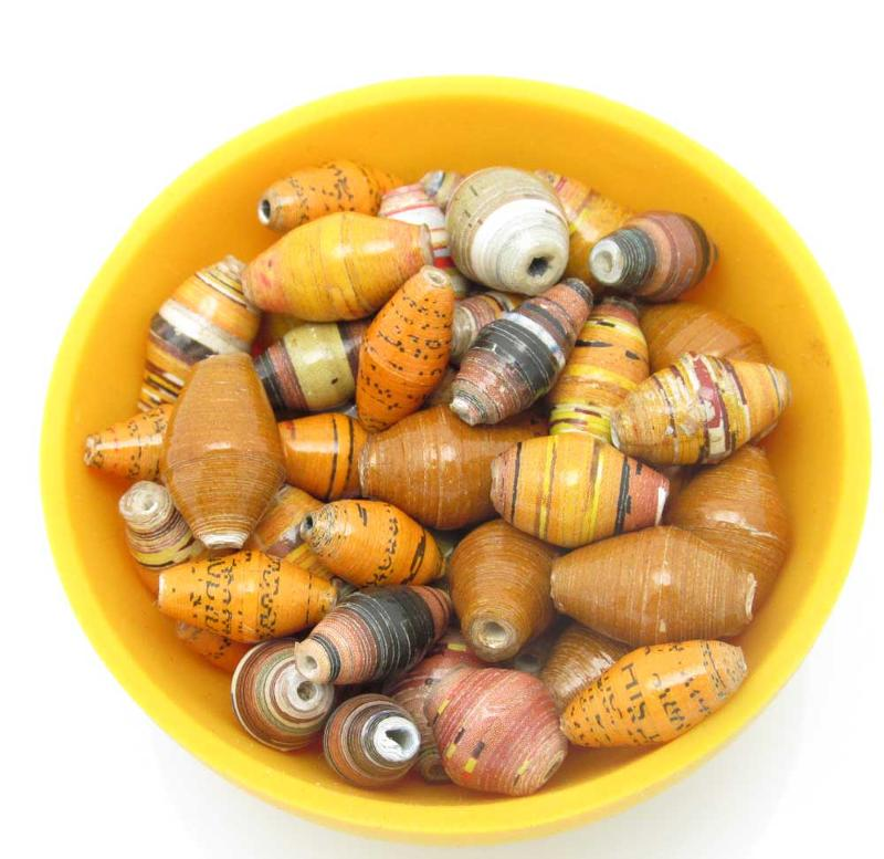 Loose beads in yellow bowl