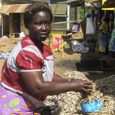 Anna Komakech sells fish from Lake Victoria.